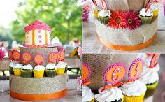 orange and pink  cupcake stand made of burlap and orange ribbon