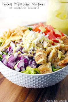 A quick and delicious chopped salad with seasoned chicken, feta cheese, crispy wonton strips and topped with a (secretly skinny) creamy honey mustard dressing!