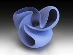 Ceramic sculpture ~ love the flow, shape and color, beautiful.