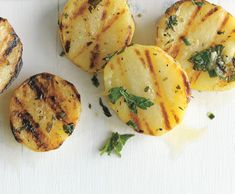"""Grilled Herb Potatoes is a new favorite recipe for the grill and we get to use all of the delicious herbs growing in the garden.  You can vary the herbs to be more """"Greek"""" ( rosemary, oregano, garlic chives) or """"Italian"""" ( basil, oregano) or """"savory"""" (sage, thyme, chives) depending on your menu, mood or most prolific herb."""