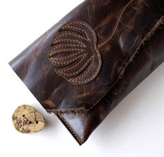 Hey, I found this really awesome Etsy listing at http://www.etsy.com/listing/126374699/leather-clutch-raw-and-rustic-flower