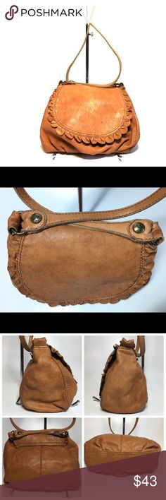 "Lucky Brand Tan Soft Leather Crossbody Flap Bag Hello All Poshers, I have a cute Lucky Brand Crossbody bag in Tan in a very Soft Leather. It is in a pre-loved but nice condition. It has ruffled like rose-petal leather cut-out edge on the flap. It is a Crossbody pleated leather bag with Lucky Brand stamped hardware on the flap. It is a very slouchy and cool bag in small to medium size. Measurements: 9"" wide, 8"" high, 3,5"" deep, 23"" shoulder strap drop. Fully lined in tan soft cotton fabric…"