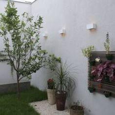 Jardim: Jardins translation missing: br.style.jardins.eclético por C+H Arquitetura