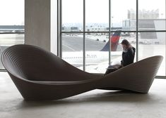 prototype of a large looping rotational-moulded bench named Folly by Ron Arad