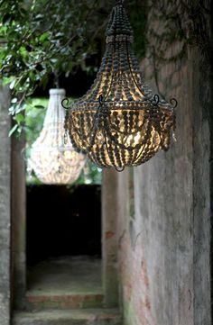 A decorative planter hook off the front of the house with a lantern, like my star one filled with white lights, or an outdoor chandelier. .....Crush Cul de Sac