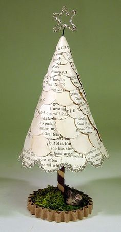 Book page tree. Love the simple cardboard base wrapped around moss.