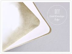 DIY gold envelope edge--Brilliant idea.  Use another envelope to mask off the tab of an envelope.  A bit of tape rolled into circles secure the first envelope where you want it.  Then lightly spray paint edge with your favorite color.  Great idea for wedding invites.