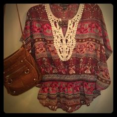Flowy boho blouse Perfect for summer with some shorts or leggings. Super lightweight and SLIGHTLY sheer. There's a comfortable cinch around the waist and the sleeves are very wide and wing-like so you can have fun pretending you can fly. True to a Women's small so if you're a junior it might be a little loose on you. Tops Blouses
