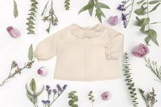 Synonymouss.com Baby girl blouse.  Synonymous offers beautiful baby + child essentials and takes the trouble out of sourcing great products so that you may shop with confidence.  Follow on Instagram @synonymousss