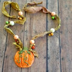 FUF 10/24 from WTW 10/22 .. Harvest Pumpkin Necklace .. Using Sari Silk Ribbon purchased from B'sue and Spectra Beads .. A light dusting of Perfect Pearls was used .. Designed by Jann Tague .. Clever Designs .https://www.facebook.com/JewelsByJann.