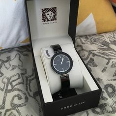 Anne Klein black ceramic watch his ceramic bangle watch from Anne Klein makes a clean, modern addition to any ensemble. With a Swarovski crystal-embellished dial and gold-tone accents, this timepiece easily transitions from day to night. It is also durable and reliable, thanks to Japanese quartz movement. This watch arrives in an elegant brown Anne Klein box for easy gifting and storage. I never wore this watch except for taking the photo, I took the protective cover off face of watch and…