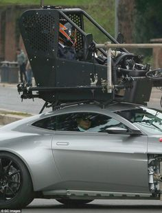 Driven! Daniel looked relaxed as sat back in the vehicle during a break in filming...
