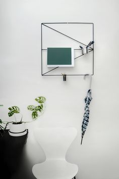 Nordic Design in a Stockholm Apartment: Wallment Arrow Grid | Arne Jacobsen Sjuan 7 Chair | Monstera Obliqua Monkey Mask Vine | Arabia Flower Pot