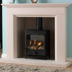 The Sunvision DEFRA wood burning and multi-fuel stove offers contemporary construction with an elegant design. The Sunvision 5 is capable of burning wood and other fuels at or greater heating efficiency Fireplace Suites, Slate Fireplace, Limestone Fireplace, Fireplace Design, Fireplace Ideas, Fireplaces For Sale, Solid Fuel Stove, 1930s House, Fireplaces