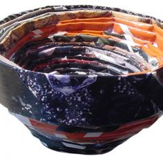 Recycled Magazine Bowls. Folded strips of magazine rolled into a bowl. #artprojectsforkids