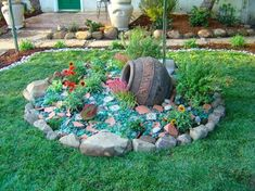 Recycled tumbled glass mixed with broken tile is used as mulch in this garden vignette