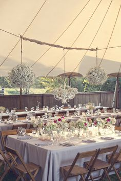 Love the chairs, centerpieces, large pomanders from this reception at Misty Farms in Ann Arbor.