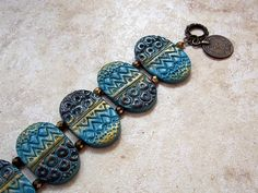 Polymer clay bracelet in brown, gold and turquoise by Orly Fuchs Gal-chen
