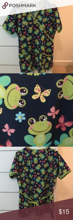 Scrub Top Scrub top with frog pattern. Navy blue background. Ties in the back. Tops