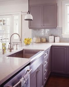 Pretty dark taupe cabinet color, light counters, backsplash with a little color