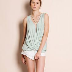 1DAYSALE Mint Sleeveless Tank Top Sleeveless tank top with a deep v. Only available in mint. Brand new. True to size. This is an ACTUAL PIC of the item - all photography done personally by me. Please do not use photos without permission. Bare Anthology Tops Tank Tops