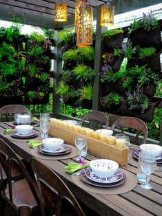 Vertical Garden - I wish I had an outdoor space for a vertical garden.  I love how cozy it makes this dinning space.  I also love those rusted, worn looking chairs too.