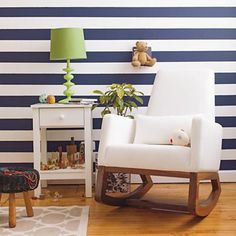 another look at striped wall in land of nod ad with white leather joya rocker