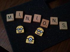 Cut scrabble tiles with my dremel to make cute little Minion earrings and necklace set. I hand painted and sealed them.
