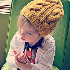 The Hipster Toddler Girl Cabled Slouchy Hat is perfect for any hip little girl! The pattern is sized specifically for toddlers, as defined as approximately 1-3 years of age.