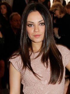 Mila Kunis straight, layered, middle-part haircut | allure.com