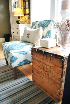 Love this old wood chest as a side table