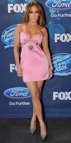 J.Lo wore a pale pink Fausto Puglisi cutout mini dress with silver embellishments. The dress is sexy and fits her like a glove!