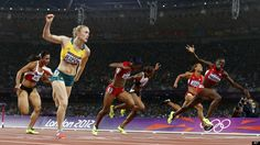 Australia's Sally Pearson, front left, crosses the finish line ahead of United States' Dawn Harper, right, to win gold in the women's 100-meter hurdles final during the athletics in the Olympic Stadium at the 2012 Summer Olympics, London, Tuesday, Aug. 7, 2012.