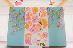 draped paper flower ceremony backdrop with painted flowers