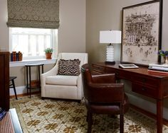 Furniture from Pottery Barn and West Elm set the tone in this comfortable, transitional home office designed to be a gentleman's study. A mix of texture and pattern add an eclectic touch inspired by world travel.