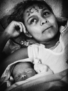 GUERRERAS: WOMEN AND VIOLENCE IN EL SALVADOR.  Chucky is a member of Mara Calle 18. She was abandoned by her mother when she was six days old and grew up in an orphanage until she was fourteen. She's currently in a women's prison. Christian Poveda /Agence VU/Aurora Photos