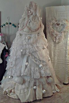 Shabby Chic Christmas Tree - made from a wood teepee shaped frame and vintage wedding dresses - via Penny's Vintage Home: My Romantic Christmas Tree Christmas Tree Dress, Unique Christmas Trees, Noel Christmas, Pink Christmas, Christmas Crafts, Christmas Decorations, Holiday Decor, Xmas Tree, Christmas Mantles
