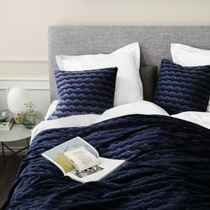 Get a good nights sleep in this luxurious bed with pillows and bedspread by danish designer Georg Jensen Damask.