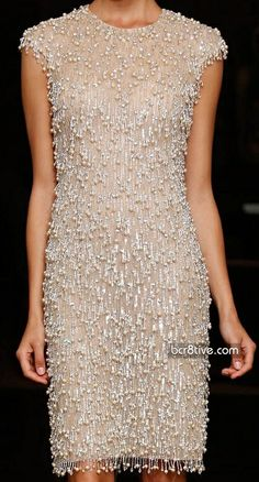 Champagne tassel fringed and cap sleeve cocktail dress.