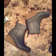Tretorn rain boots Grey Tretorn rain boots. Wedge heel only worn a couple of times Tretorn Shoes Winter & Rain Boots