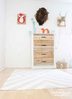 Paint a simple canvas drop cloth to make a patterned rug.
