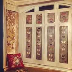 Butterfly decoupage shutters against original old wallpaper, in my Shropshire Farmhouse.