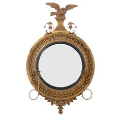 Gilt Convex Mirror with Eagle Crest   From a unique collection of antique and modern wall mirrors at https://www.1stdibs.com/furniture/mirrors/wall-mirrors/