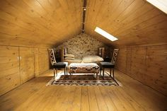 attic bedroom design and chairs