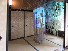 Installation at INAKA art, Nakake House, Kumatori, Japan In cooperation with Kanako Uemura.  Photo: Christine Maringer.  Lasercuts in fabric, silk thread, lead, video