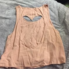 Open Heart Back Tank Top NEVER WORN! super cute, flowy tank top. Not from free people, but in the category for exposure. Originally from nordstroms bp Free People Tops Tank Tops