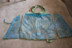 Make a great re-usable bag from a broken umbrella, it even rolls up nicely to fit in your purse!