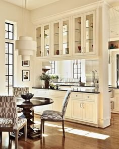 Breakfast room. Pass-through to kitchen that's big enough to actually work. Glass cabinetry. Windows. East morning light.... Chancellor's Residence by Dean Marvin Malecha