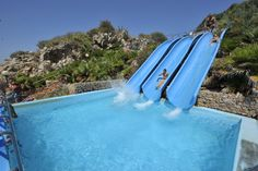 Citta del Mare hotel village on the Italian island of Sicily has 3 pools linked with slides that face the ocean.  How cool is that?