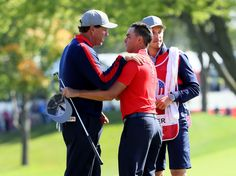 Rickie Fowler Photos Photos - Phil Mickelson and Rickie Fowler of the United States react at the end of their round during morning foursome matches of the 2016 Ryder Cup at Hazeltine National Golf Club on September 30, 2016 in Chaska, Minnesota. - 2016 Ryder Cup - Morning Foursome Matches